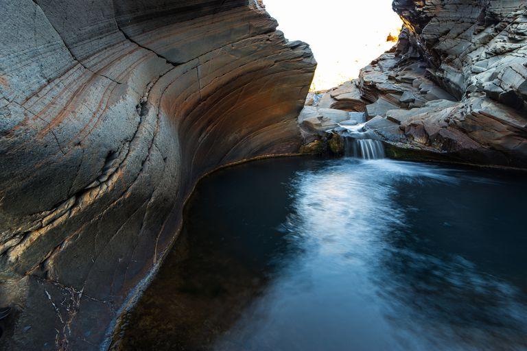 scenic-view-of-waterfall-733268099-59639a505f9b583f180f2b3d.jpg