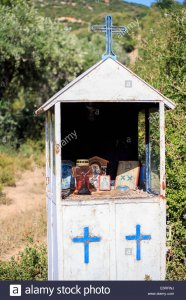 greek-ikons-inside-roadside-shrine-E6RRNJ.jpg